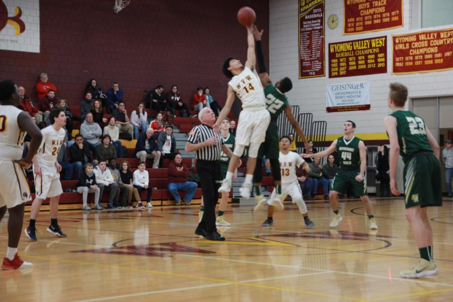 Draig Ruff, 14, jumps for the ball at the start of the game.