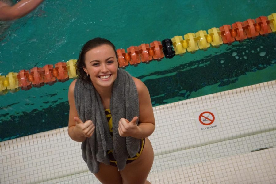 Sophia Ginochetti smiles after she broke her own pool and school record